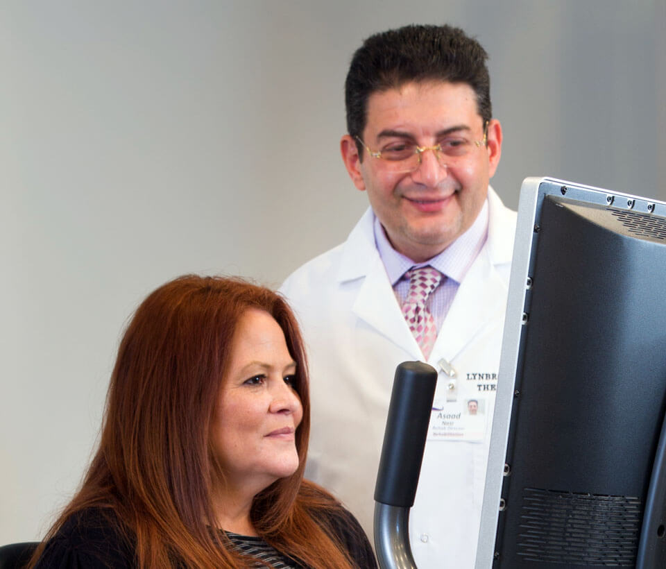Lynbrook Restorative doctor with patient